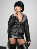 Black haired lady Stella Van Gent in high boots loves leather and cigarettes