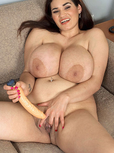 Plump big tit latina Haydee Rodriguez takes off her maid uniform and lingerie before taking dildo