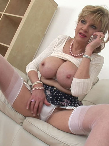 Lady Sonia ready for some hardcore fetish while on the phones ans slowly masturbating her slit.
