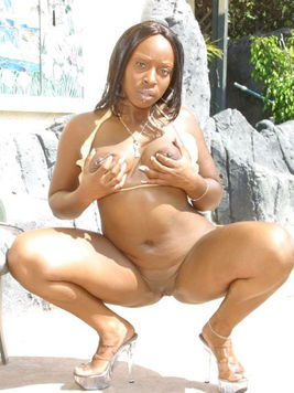 Ebony lady Skyy Black with big breasts and shaved puffy pussy removes her bikini and sucks