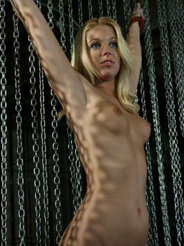 Completely naked sexy bodied slave blonde Hollie Stevens is a lesbian slave of unmerciful woman