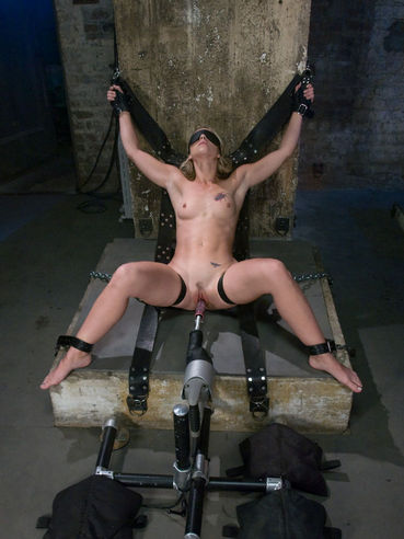 Blindfolded Melanie Jayne gets bound with her legs apart then takes robotic dildo.
