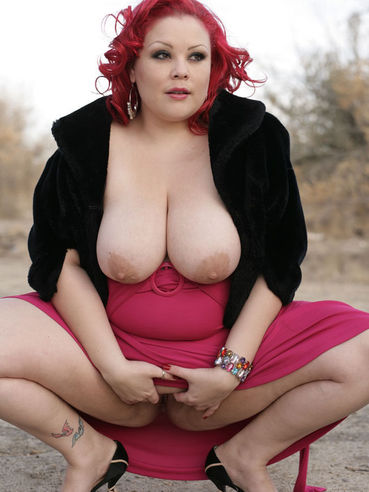 Redhead woman April Flores in pink dress exposes her painted toenails and flashes her snatch