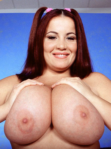 Sexy dressed attractive fattie Annie Swanson with charming smile exposes her juggs