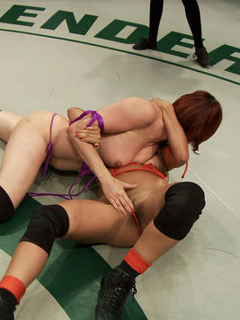Reena Sky and hot Odile get down and rub each other's hot slits during a cat fight.