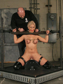 Master takes care of tits and pussy of slave blonde Bridgette B in high black boots