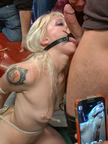 Slutty tattooed blonde Elyssa Greene with small tits gets gagged, tied up and gang banged hard.