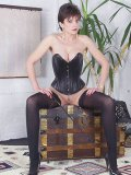 Lady Sonia in a leather corset with her fetish loving slit exposed posing and expertly teasing.