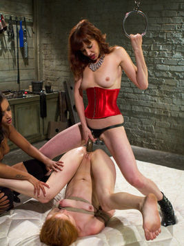 Bondage lover called Maitresse Madeline makes a poor babe scream while gagging her and fisting her.