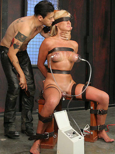 The first punishment for big boobed slave blonde Val Malone is getting her tits pumped