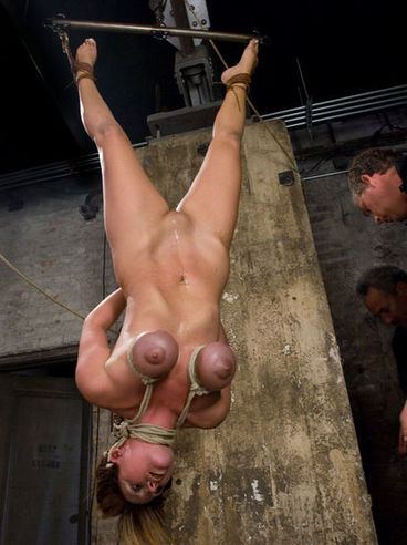 Massive titted milf Christina Carter gets tied and suspended by two experienced masters