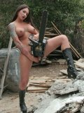 Tattooed beauty in boots Superna poses naked with saw showing off her big tits and smooth snatch
