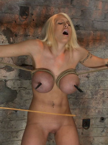 Helpless blonde Candy Manson gets her huge round boobs and smooth pussy punished