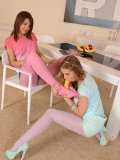 Alexis Brill making fetish lover Alexis Crystal moan while her legs and privates are licked up.