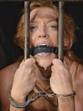 Blonde Simone Sonay gagged and caged after her tits have been tied during hardcore bondage.