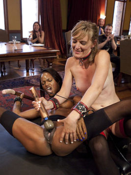 Fetish babe Marie Luv gets her tight ebony body fucked and stretched by strap-on chick Mona Wales.