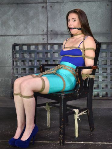 Casey Calvert tied with ropes and getting her muff vibrated while spreading her legs.
