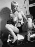 Alternative fair haired model Lynn Pops demonstrates her tattooed feet in the dark