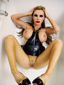 Gothic looking bombshell Nikki Benz gets naked in the bathroom to make some nasty alt porn