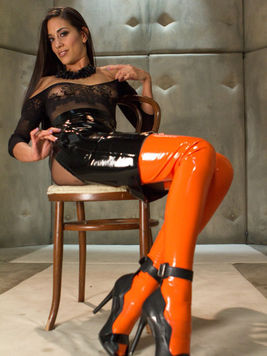 Latex loving Lyla Storm jerks off a foot fetish lover's cock using her sexy feet.