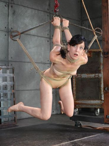 Elise Graves suspended and nipple pinched while above ground during bizarre bondage.