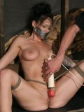 Sexy Krissy Kage with big tied tits gets tortured with clothes pegs and whipped after suspension