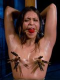 Bound brunette Thea Marie gets her mouth stretched with thick dildo and her tits clothespinned