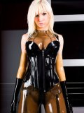 Big titted rubber babe Susan Wayland shows off her sexiest see through suit