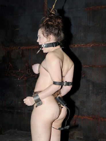 Restrained brunette Charlotte Vale with mud on her face gets her helpless holes dicked