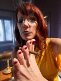 Classy babe Maitresse Madeline shows a guy the world with foot fetish and smoking action