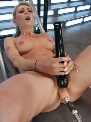 Horny blonde Natasha Starr squeezes her tits and cums hard while the machine fucks her wildly.