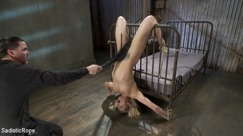 Slave gets on wheel and bound with rope and cuffs by dom