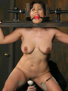 Asian slave girl Jessica Bangkok gets her big tits and juicy pussy mercilessly used in the dungeon