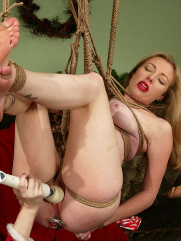 Lesbian slave girl Adrianna Nicole gets her holes tortured on Christmas