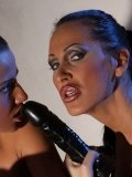 Short haired Sinead strips out of her latex clothes for Mandy Bright to watch