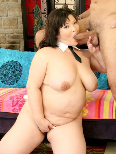 Big titted thick asian Kelly Shibari takes off her outfit and sucks cock for sperm