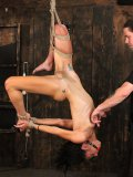 Rope bound tight naked slave brunette Caddy Compston gets her tight hairless pussy vibrated