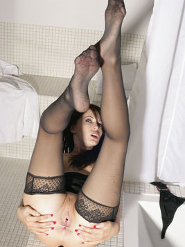 Lovely Jenna Presley gets in the bathtub with her black nylon stockings on