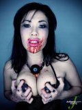 Ball gagged black haired oriental lady London Keyes demonstrates her dirty tits