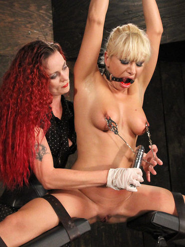 Blond Lea Lexus in black shoes and red undies gets dominated by long haired auburn Mistress Melissa