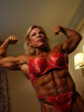 Topless middle-aged bodybuilder Lauren Powers shows off her hard muscles and big tits