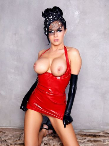 Isabella Fierra in latex red dress and long black gloves exposes her big breasts and pussy