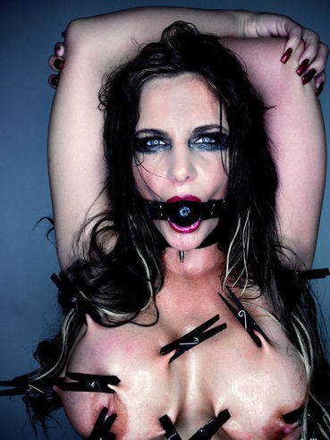 Alt porn bombshell Phoenix Marie has some BDSM fun with a mouth gag and clamps on her knockers