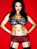 Frisky pornstar Monica Mendez posing in bra, panty, stockings and garter-belt