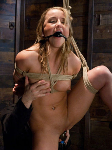 Teenage slave girl Jessie Coxxx gets her shaved pussy torture and her tiny ass caned and fingered