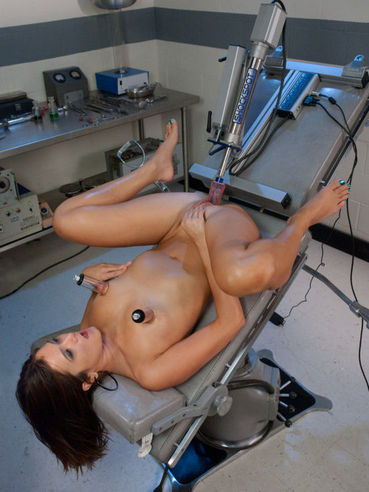 Slim brunette CeCe Stone rides the dildo machine and gets her nipples stimulated