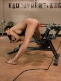 Oriental girl Lana Violet gets her tight exotic hole drilled by dildo machine doggy style