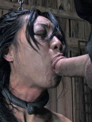 Restrained oriental slave woman Tia Ling gives head to her thick dicked master