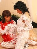Tera Joy and Veronica Vanoza get wet and messy in the middle of a huge bed