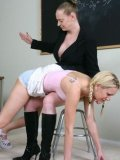 Blonde schoolgirl Erin Moore gets her tiny ass spanked by her strict teacher in smart black suit